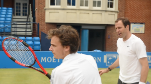 Serving with former world number four Greg Rusedski during a media coaching clinic on the Centre Court at Queen's