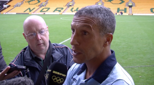 Norwich boss Chris Hughton talks to the assembled media