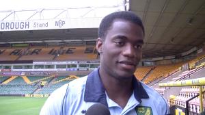 Norwich skipper Sebastien Bassong talks to the media